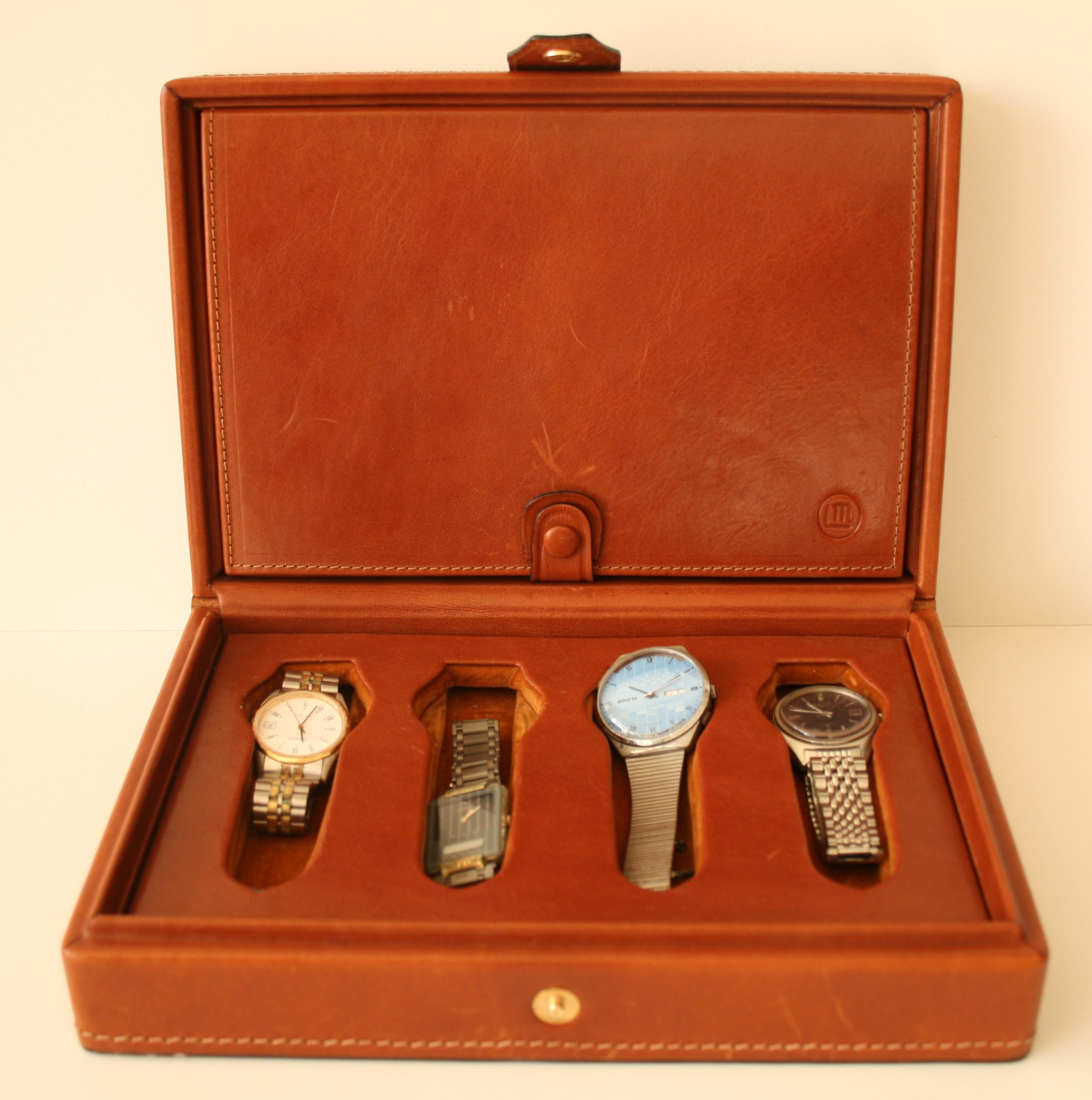 Lot 49 - Boîte de rangement pour 8 montres, plein cuir brun - Dimensions : 18 x 27 x 8 cm - [...]