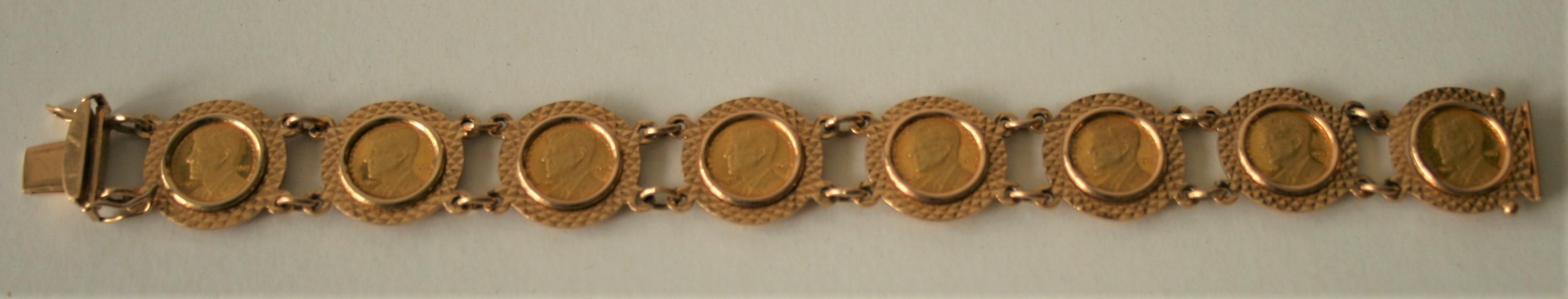 Bracelet en or 18 ct comportant 8 pièces en or à l'effigie de J.-F. KENNEDY [...]