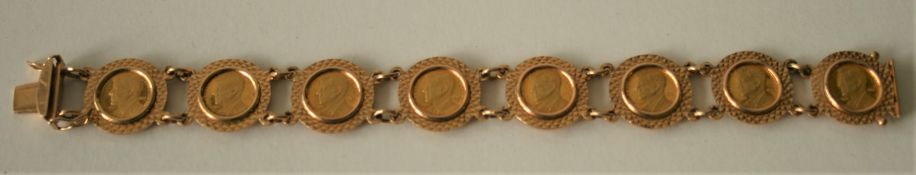 Bracelet en or 18 ct comportant 8 pièces en or à l'effigie de J.-F. KENNEDY [...]