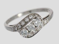Ring: zierlicher weißgoldener Diamantring, insgesamt ca. 0,5ct, 14K Gold<