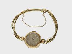 Armbanduhr: sehr frühe Damenarmbanduhr, um 1925, 14K Gold
