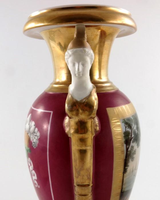 Lot 502 - A pair of Paris porcelain twin handled vases,