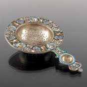 An Imperial Russian silver gilt and cloisonne enamelled tea strainer, 11th Artel, Moscow circa 1908