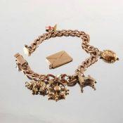 A 9ct gold charm bracelet, suspending five charms