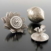An Oriental white metal box in the form of a lemon, together with a filigree flower head finial