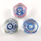 Whitefriars, three Christmas design millefiori faceted paperweights, 1975,1977,1978