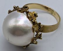 A 14ct gold and pearl ring, 7g, size P ½