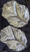 A pair of French leaf glass dishes