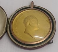 A Russian Alexander I yellow metal medallion within rose gold mounted and red leather case, D.5cm