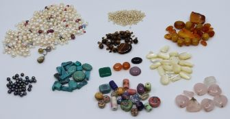 Collection of pearls, semiprecious stones and Chinese beads to include tigers eye, turquoise,