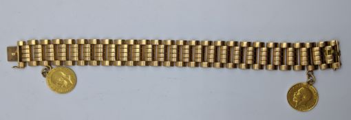 An 18ct yellow gold bracelet mounted with two half sovereigns, 53g, L.20cm W.1.5cm
