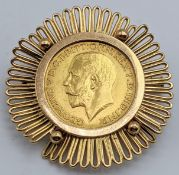 A 1912 George V gold sovereign within an 18ct yellow gold mount, marked 750 to clasp, total item