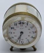 A late 19th century mother of pearl clock miniature travel clock, the face marked R.W., H.4cm