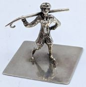 A Russian silver study of a skater, marks to base, H.3cm