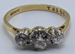 An 18ct yellow gold and platinum diamond ring, approx.1cts combined, 2g,