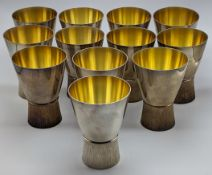 A set of 10 Brian Fuller silver and gilt goblets, hallmarked London, 1984, glis glis dormouse logo