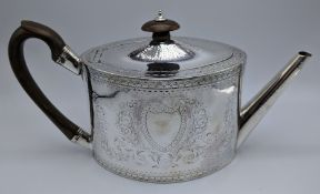 A George III silver teapot, scrolling floral and foliate decor, vacant cartouche to both sides,