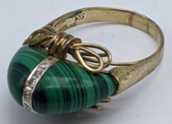 A 14ct yellow gold ring mounted with malachite and central band of small diamonds, 6.9g,