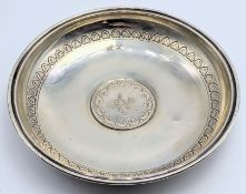 A Turkish silver dish with central silver coin, marked to inside, etched outer band, 64g, D.13cm
