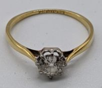 An 18ct gold and platinum diamond ring, approx.0.5cts, 1.5g
