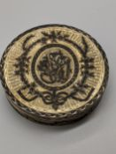 A late 18th century Russian silver-gilt and niello circular pill box, marks inside for Moscow