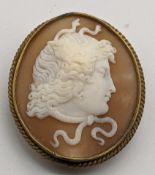 A gilt metal cameo brooch, H.4.5cm