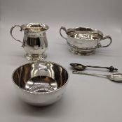 A collection of silver to include to include a twin handled quaich with Celtic style banding, W.15cm