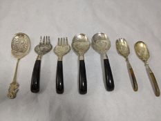 A collection of Malaysian silver cutlery to include, one of the large forks and spoons with the