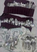 A collection of silver plated flatware and cutlery