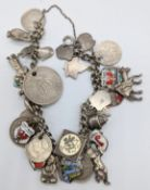 A silver chain bracelet with silver charms and coins, various marks, 63g