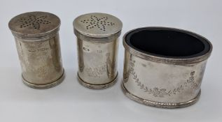 An early 20th century silver cruet set, blue glass liners, hallmarked Birmingham, H.5cm