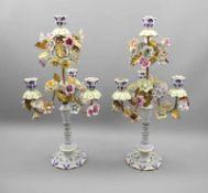 """Zwei Kerzenleuchter mit PorzellanblumenPorzellan, ein Leuchter am Boden """"Italy"""" bezeichnet,"""