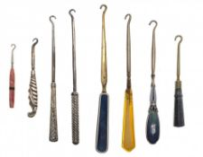 Eight shoe and glove pullers (button hooks)