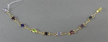 Armband 18 kt. Gelbgold, 9 geschliffene Edelsteine, farbig, Krampenfassung, Kastenschloss mit