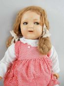 Puppe, wohl K&R, Massekopf, rot gepunktetes Kleid, um 1930, bespielt, 54 cm