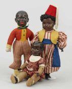 Drei CharakterpuppenMasse und Keramik. Charakterköpfe mit geöffneten bzw. geschlossenen Mündern