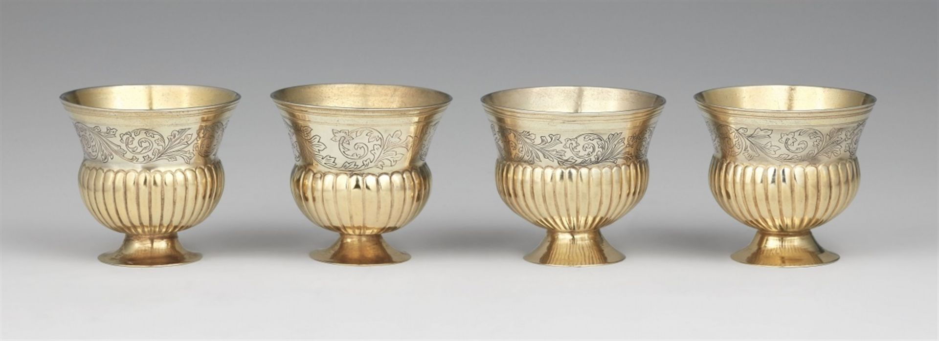 Los 730 - Four Augsburg silver beakersSilver; partly gilded. Parcel-gilt silver beakers with moulded rims