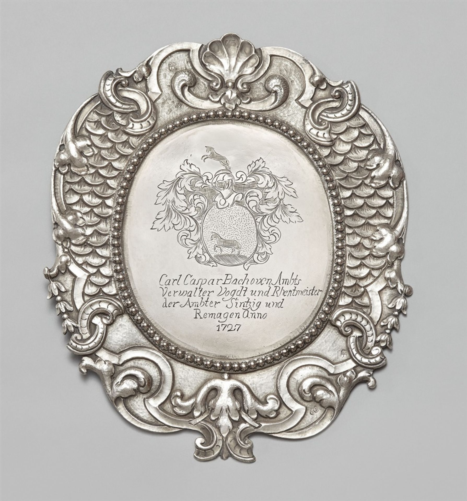 Los 755 - A Sinzig silver official shieldSilver. Oval cartouche form shield with chased règence décor to the