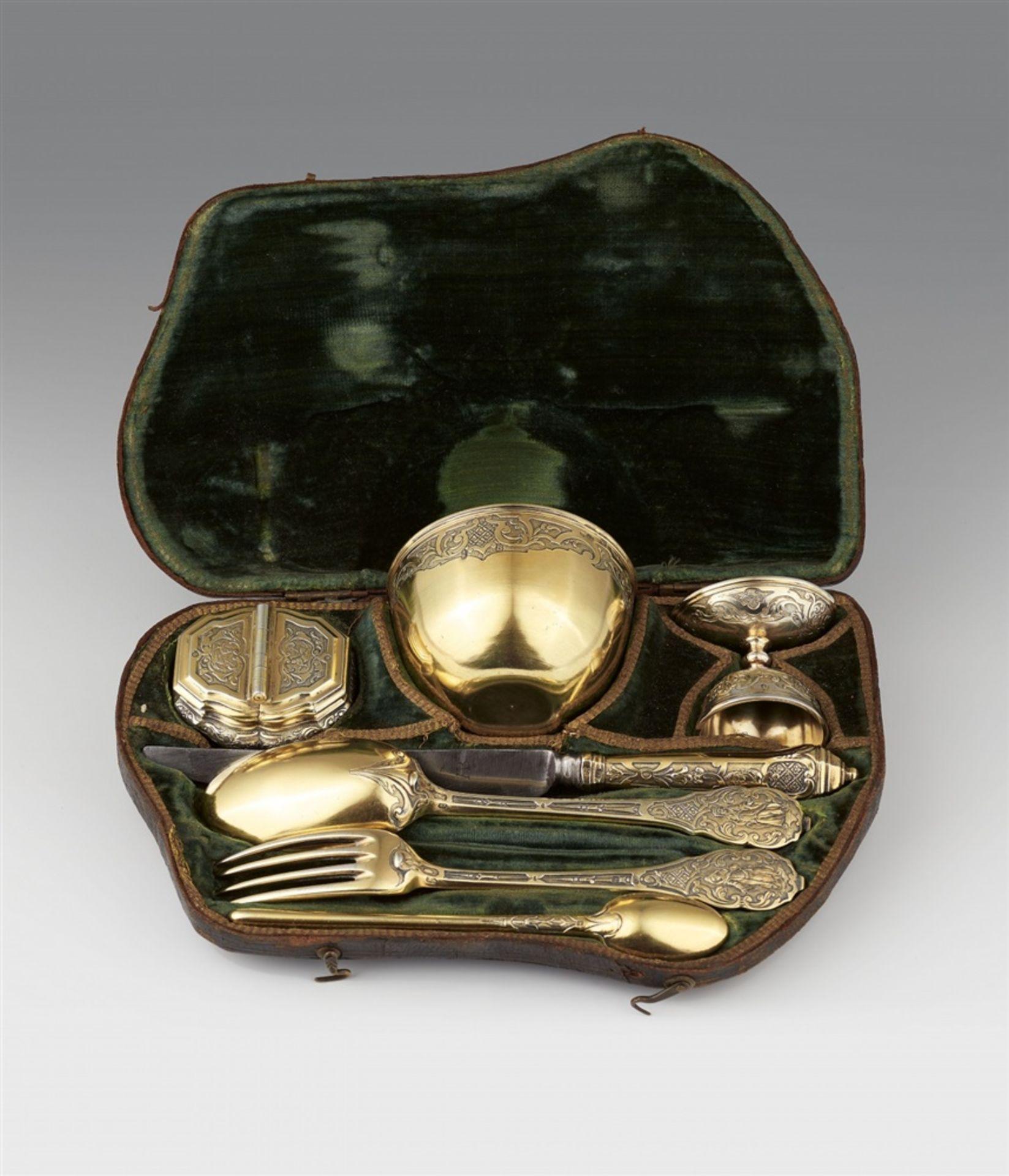 Los 710 - A museum quality Augsburg silver travel dining setSilber; vergoldet. A silver gilt garniture