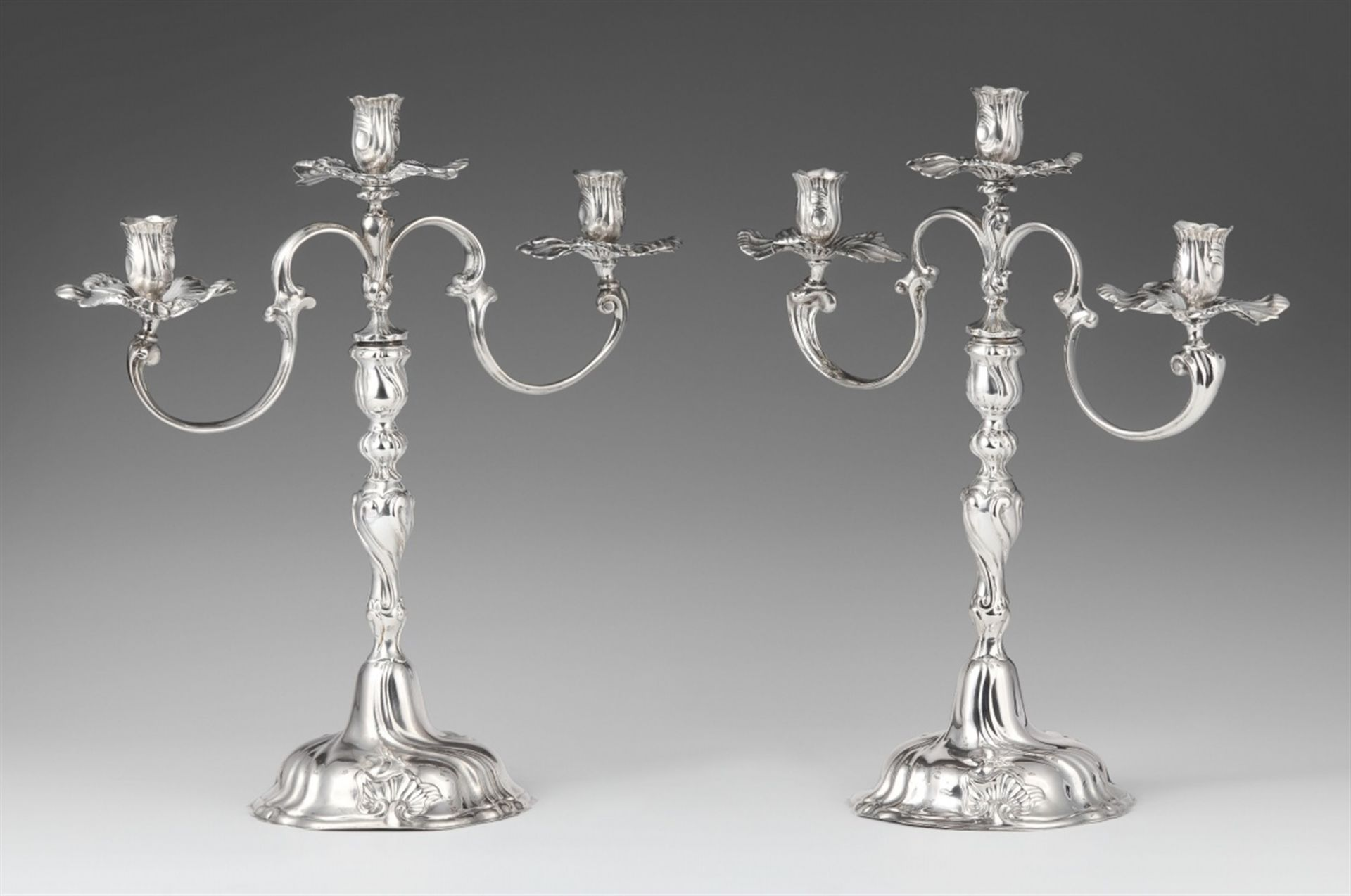 Los 737 - A pair of Braunschweig silver candelabraSilver. Baluster-form shafts with shellwork décor and