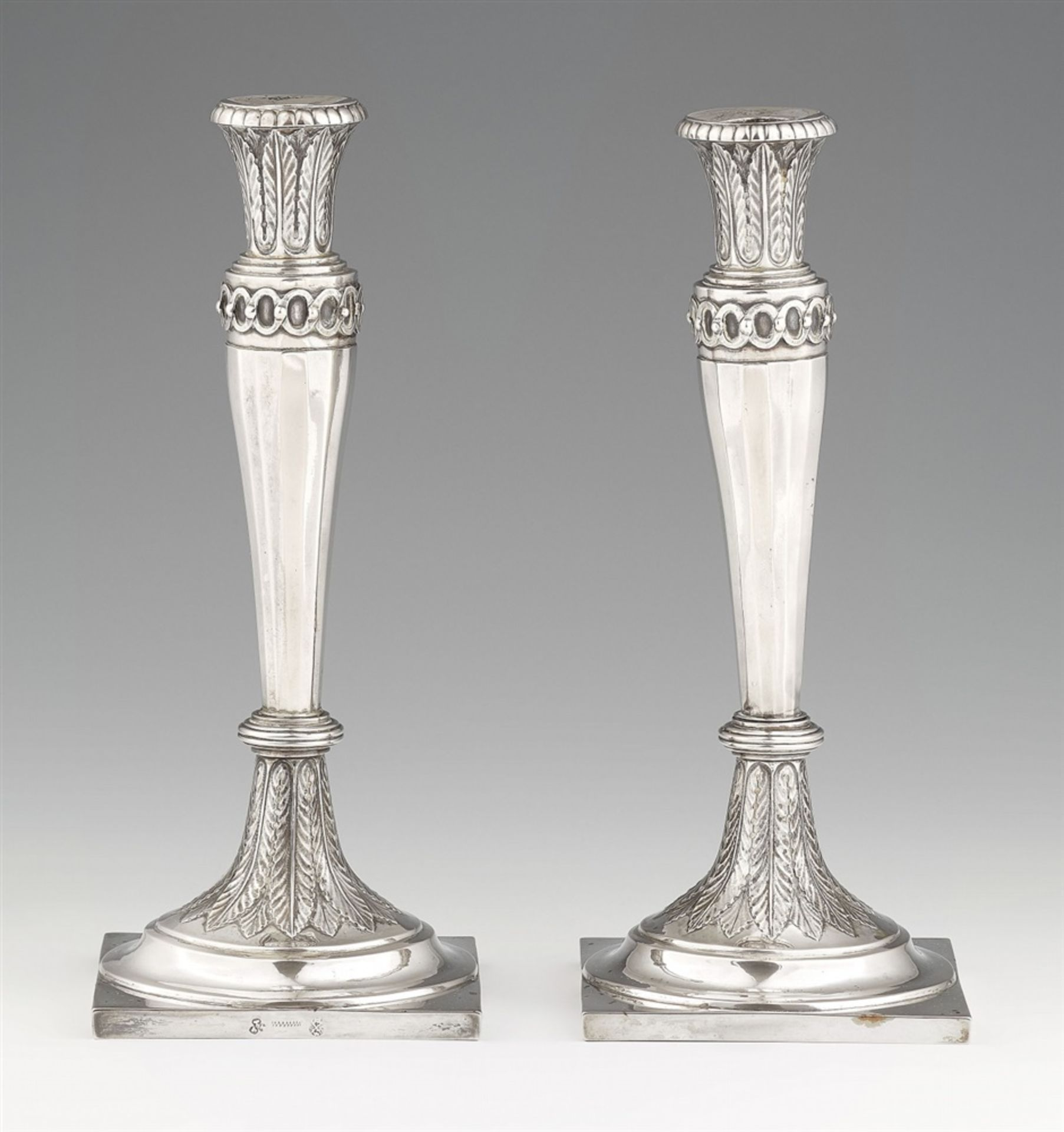 Los 747 - A pair of Weißenfels silver candlesticksSilver. Square bases with lancet décor supporting tapering