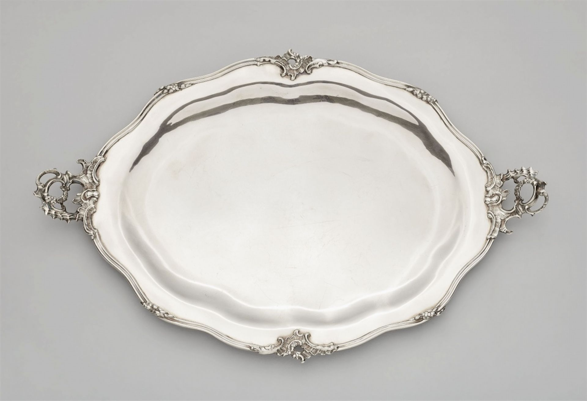 Los 729 - A large Augsburg silver platterA moulded silver platter with rocaille handles, the narrow rim with