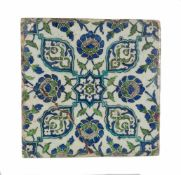 A damascus pottery tile ottoman. Syria. Circa 1565-1570. The white ground decorated in cobalt-b