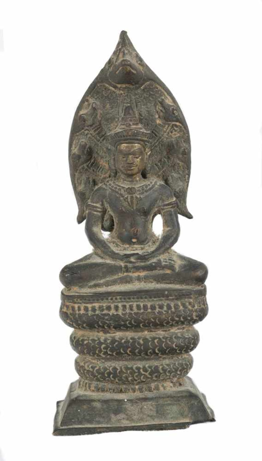 """Los 54 - A partially gilt bronze figure. Probably Camboya. 17th-18th Centuries. """"Buddha protected by Muc"""