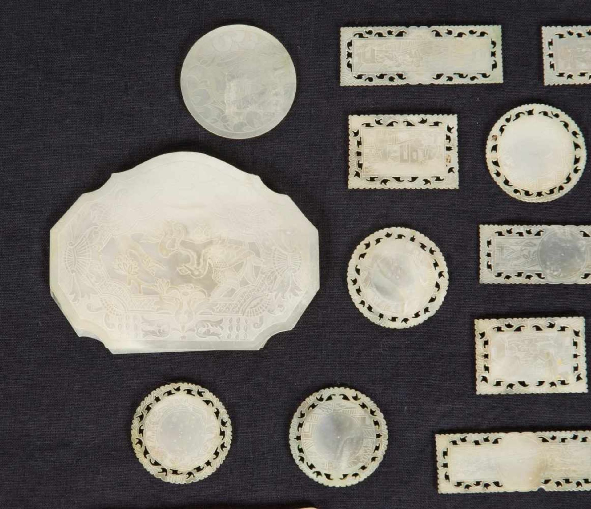 Los 43 - A set of carved mother of pearl gaming counters. China. 19th Century.