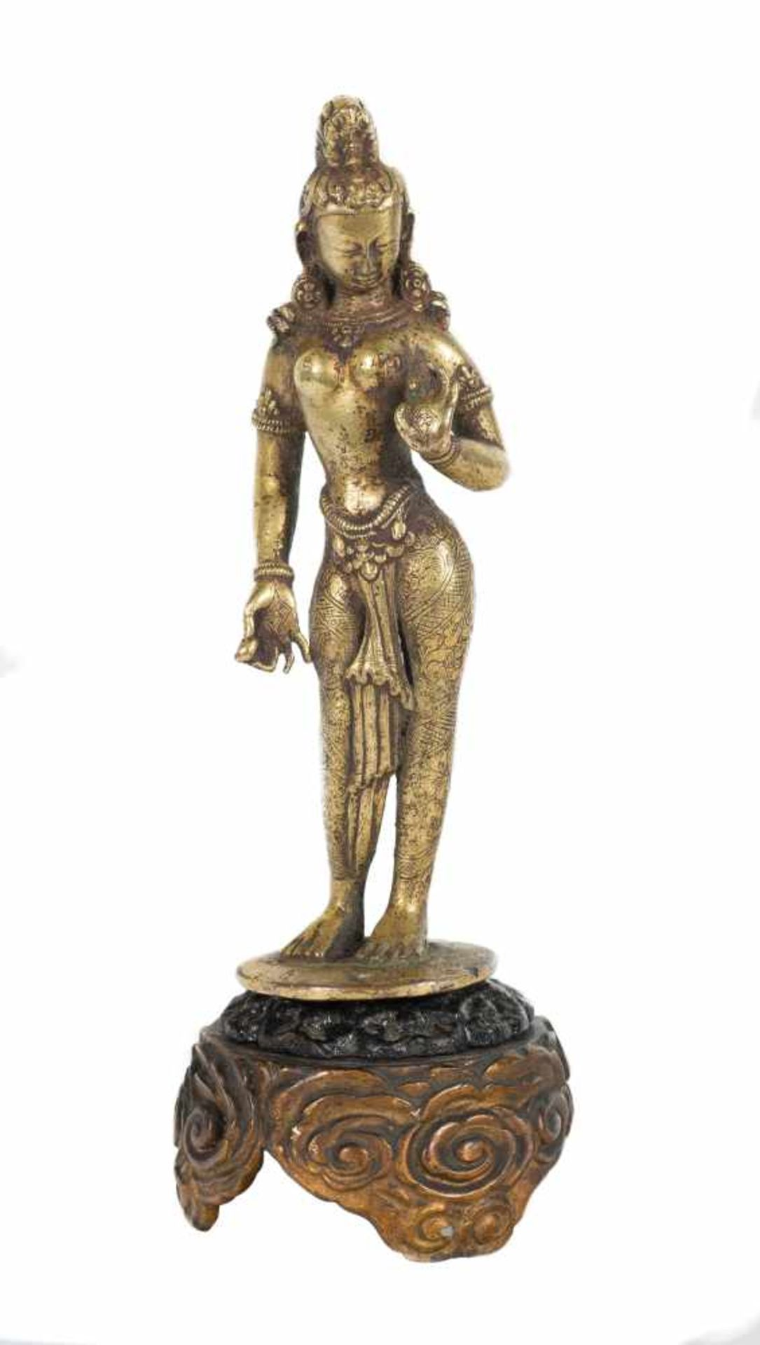 Los 38 - A gilt-bronze figure of standing Tara. Tibet. 17th-18th centuries. Depicted with her left hand