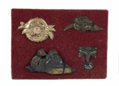 A set of four Japanese menuki. Edo period. 18th-19th Centuries.4 x 2 cm., 3 x 2 cm., 3,5 x 1,5