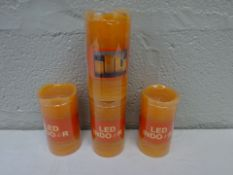 BRAND NEW X4 ORANGE WAX LED INDOOR BATTERY POWERED CANDLES.