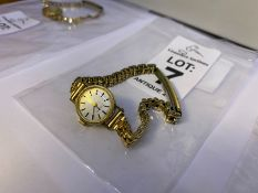 9 CARAT GOLD BULOVA LADIES WATCH WITH GOLD PLATED BRACELET