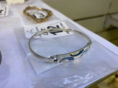NARROW SILVER STAMPED BANGLE WITH STONE SET PLATE